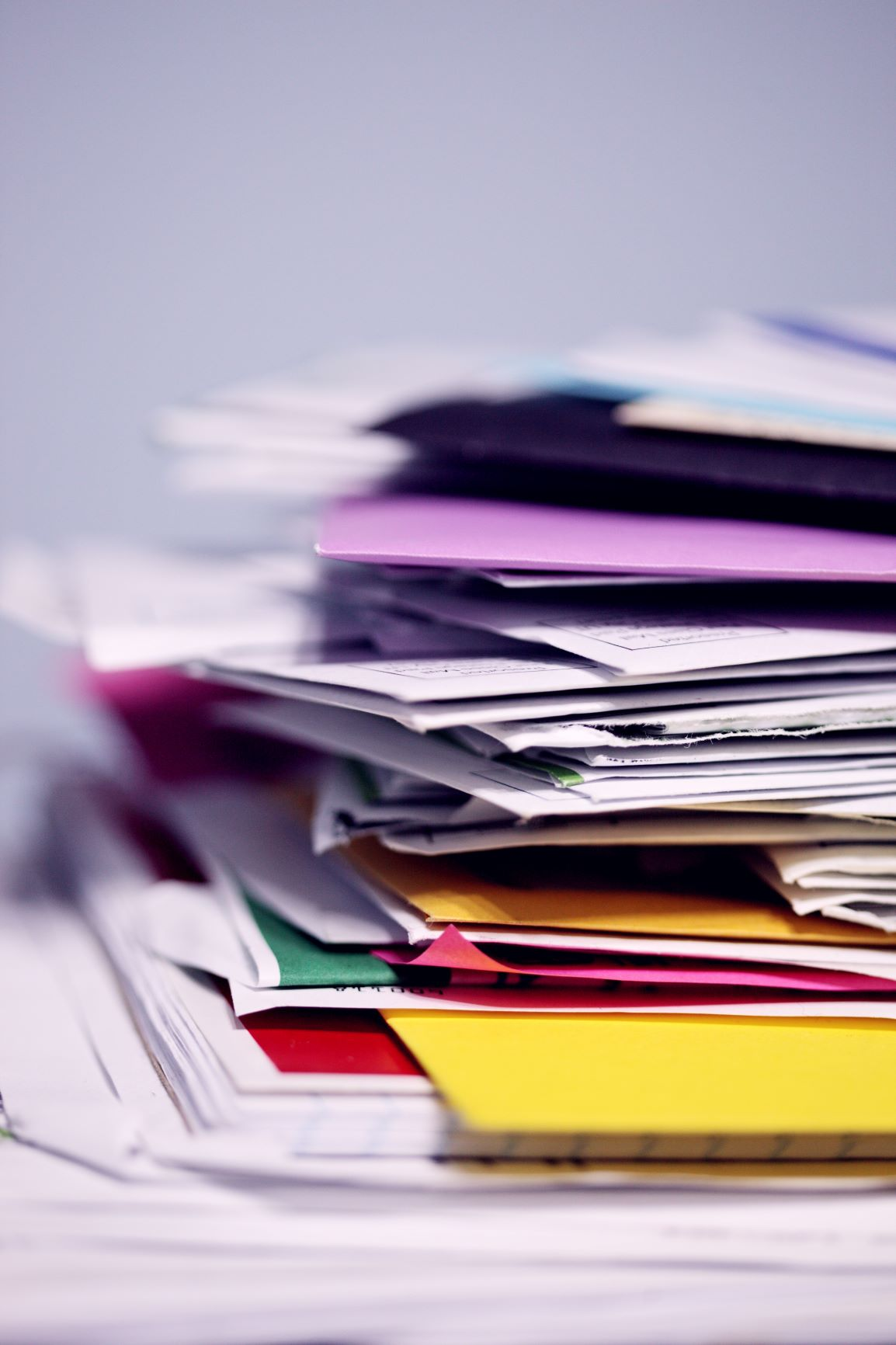 Pile of papers on a white desk