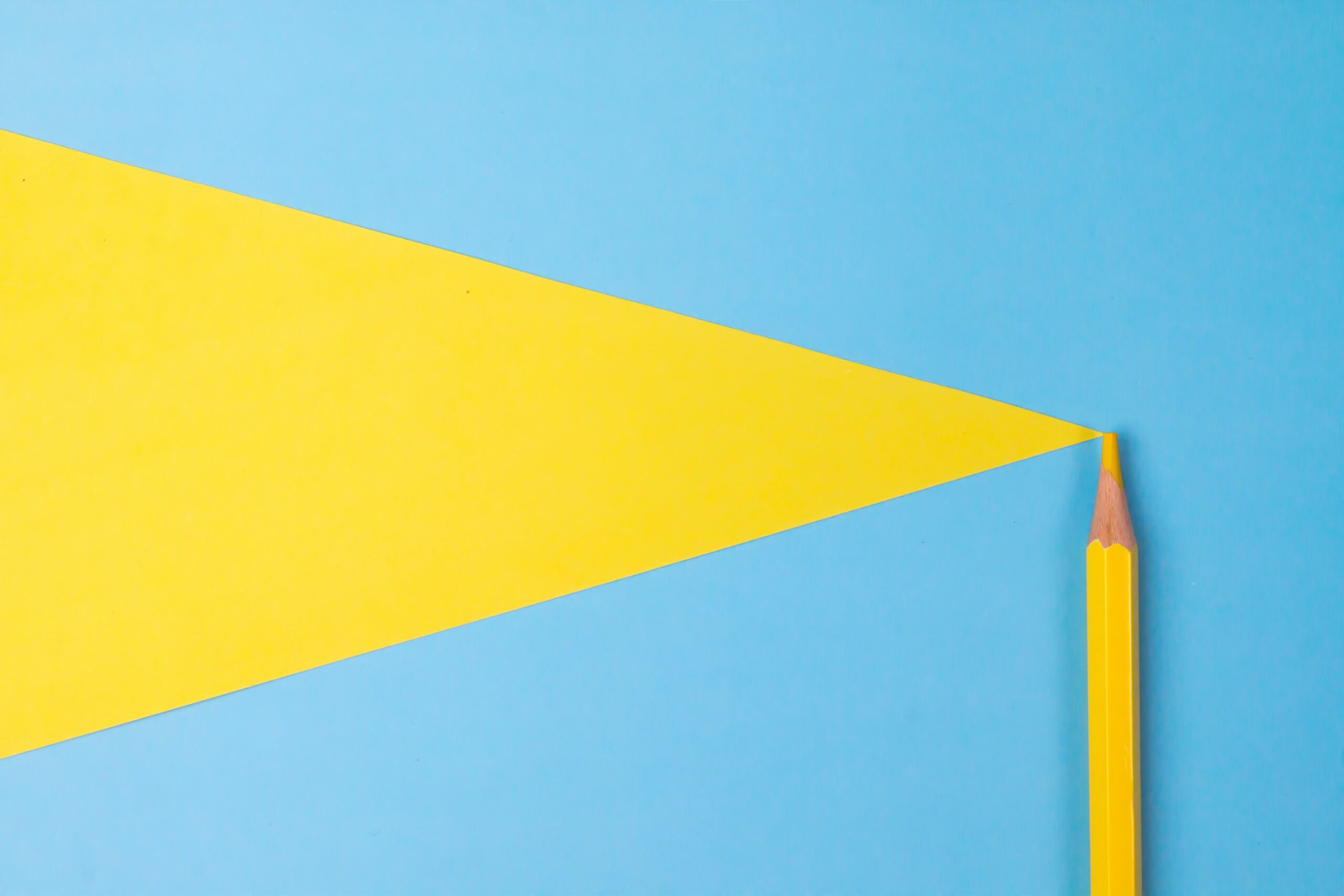 yellow pencil on a light blue background - Photo by Tamanna Rumee on Unsplash